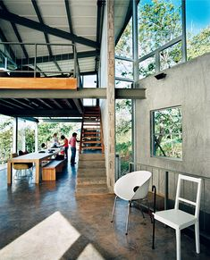 On the outskirts of San Salvador, El Salvador, architect Jose Roberto Paredes designed a ground-level tree house for his family that favors texture over color, letting the jungle surroundings choose the hues.