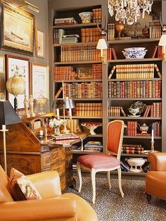office with coral accents floor to ceiling bookshelf library... divine....