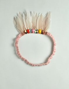 feather and jewel crown! Holy Crap Ellie is going to love this!. now I need to get some feathers and jewels!
