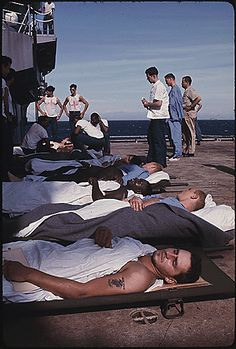 Wounded Marines on the deck of the Amphibious assault ship USS Tripoli await transfer to the Casualty Station in Danang from which they will be sent to the States, July Vietnam History, Vietnam War Photos, Vietnam Veterans, American War, American History, Usmc, Marines, Naval History, Military History