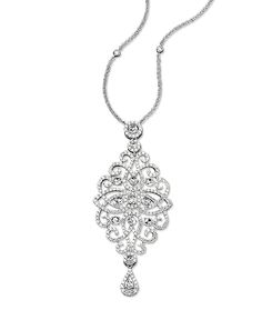 Cellini Jewelers Open Work Diamond Pendant 2.51 carats of round brilliants and 1.26 carats of rose cut diamonds make up this stunning open work pendant. Set in 18 karat white gold.