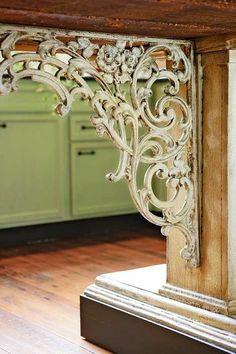 Decorative iron brackets with timeworn finishes add texture and character to the kitchen.