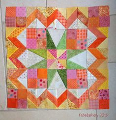 bonnie hunter's celtic solstice mystery quilt block (in progress), from frances on the fabadashery blog, in yellows, oranges, pinks, & greens