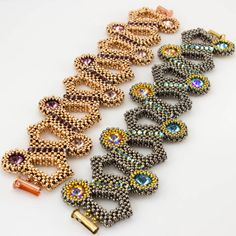Beads Gone Wild Alchymia bracelet right-angle weave & cubic right angle bracelet with bezeled Swarovski Elements capping the different twists and turns.