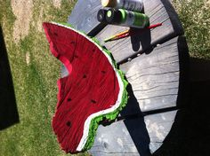 My outside garden art - a tree trunk wedge painted into a slice of watermelon