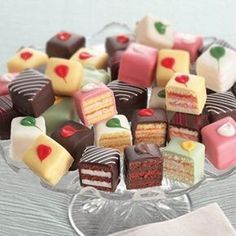 Learn how to make these precious stenciled petit fours with our step by step picture tutorial. This recipe will make a total of 16 petit fours. (How To Make Butter Cream) Fancy Desserts, Just Desserts, Frozen Desserts, Gourmet Desserts, Tea Party Desserts, Frozen Appetizers, Mini Dessert Recipes, Bite Size Desserts, Mini Cakes