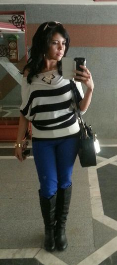 Black and white top and cobalt blue pants