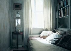 Love the soft blue and gray of this room....looks like a perfect place to read on a cold winter's day