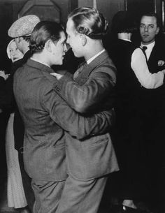 "Two men dancing at Magic-City dance hall's ""drag ball"" two blocks from the Eiffel Tower in Paris. These gay balls were held annually until the venue was shut down by authorities in 1934.  By Hungarian photographer and artist Brassaï."
