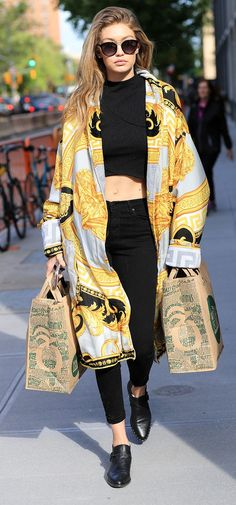 Gigi Hadid wears Versace coat with knit crop top, black skinny jeans and pointed toe flats