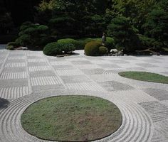 """Garden of the imagination: """"Karesansui, or 'dry gardens,' are quiet works of landscape art. Rocks, gravel, sand, and moss are arranged to represent mountains, rivers, and islands.... In a Zen garden the sand is raked in waves and circles to suggest the movement and ripples of water."""" Caption from link (Image 2 of 4)"""