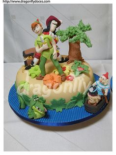 "https://flic.kr/p/76tRLD | Peter Pan Cake 2 / Bolo Peter Pan 2 | Two Peter Pan ""themed"" cakes (made for the same party). On the top of the 3 tiers one, there is a figurine based on the birthday boy (here dressed as Peter Pan). On the other two tiers there are figures of the Darling siblings (Wendy, John and Michael), of the Lost Boys (Tootles, Nibs, Slightly, Curly and the Twins) and of the mermaids of Neverland. All made with gumpaste (some of which were the smallest gumpaste ..."