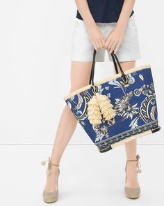 The beach tote gets a new-season update in paisley floral with straw trim and chic tassels. Handbags | White House Black Market