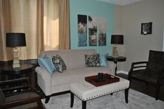 This is the finished living room for the apartment for homeless women veterans at the Clarksburg mission. The wall is a robin's egg blue behind the couch and the color scheme was taupe/khaki, creamy white brown and an accent of the robins egg blue and black.