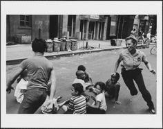 A policewoman plays games with community children in New York CIty, 1978. © Leonard Freed — Magnum Photos / Museum of the City of New York.