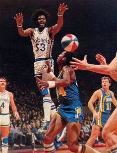 Ky v hated Indiana Pacers, 74, I'm guessing. Wendel Ladner (4) & Billy Keller of Pacers look on.