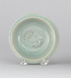 """CELADON PORCELAIN DISH Ming Dynasty  With double fish center and ribbed sides. Diameter 5"""" (13.8 cm)."""