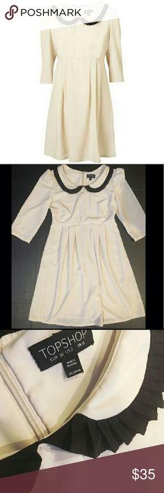 "Peter Pan Collar  Dress Stunning TopShop dress with black pleated Peter Pan collar. Hidden back zipper. Great used condition! *Discount w/ bundles!!!  Approx. Measurements: Waist: 13"" Chest: 16"" Length (Shoulder to hem): 32"" Topshop Dresses"