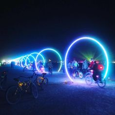 hese giant LED hoops react to music being played around them! Walking/Riding through it was absolutely Amazing! Check our IG Design D'espace Public, Kunst Party, Art Steampunk, Burning Man Art, Burning Man Night, Deco Led, Psy Art, Foto Instagram, Event Lighting