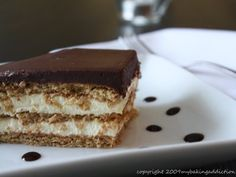 Layers of graham crackers, pudding, and chocolate marry overnight in the refrigerator to create a stunningly creamy and delicious cake.