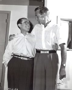 Silent star Harold Lloyd standing with Gary Cooper.