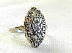 Striking art deco 1020s navette shaped diamond ring. Genuine round cut diamonds are set in 14K white gold.