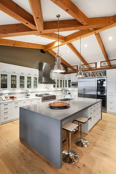 Cliffside Home by Icon Developments   Love the ceiling design and the floors.