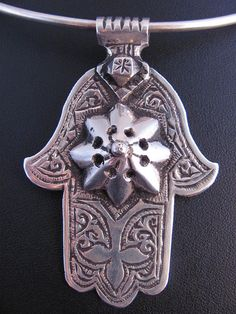 Embossed silver hamza from Morocco.