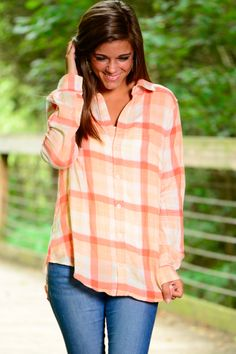 WOW! Is there a better button-down that this one?! We think not! Perfect for the fall and we love the coral and peach color combo! This plaid print has so excited for fall!