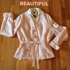 """Simply Stunning Jacket/Top What a Beauty!!!  A shimmering soft pink jacket / top. To thin to be a jacket should be worn as part of your outfit, but a shell or blouse is needed underneath. So much detail!!!  A tie belt which can make gathers around the waist, button closure. Button down front pockets. Very Classy!!!  64% Linen, 36% Cotton. Measures 24"""" from shoulder to hem, 20"""" bust and 18"""" waist. Coldwater Creek Jackets & Coats"""