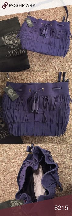 NWT AUTHENTIC Vince Camuto Bucket Fringe Bag NWT AUTHENTIC Vince Camuto Bucket Fringe Bag. Color: Blue. style: VV-RIQUI-DS group RIQUI drawstring. comes with dust bag! never used Vince Camuto Bags