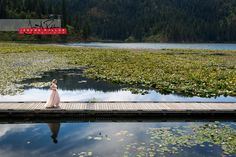 Lynze makes her way along the Fernan Lake dock to see Dan for the first time on her wedding day. #wedding #documentary #coeurdalene #idaho #portrait #bride #groom #dock #lake #lilypads #firstlook #greatscene