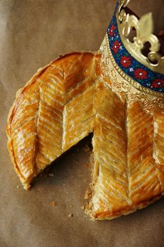 A French tradition served in celebration of Epiphany, January 6th. A fève (bean) is baked into the tart and whoever gets the bean (preferably a child) gets to be roi (king) for the day and wear a gilded paper crown!