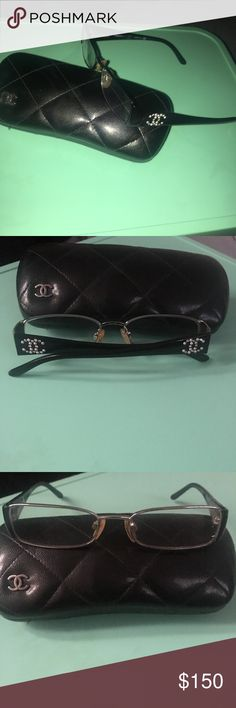 Authentic Chanel Glasses Black glasses with silver frames. Rhinestone and pearl logos on each side. Nose pads will need to be replaced. Lenses are not prescription. Minor wear inside please see picture. CHANEL Accessories Glasses