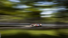 Lewis Hamilton's McLaren creates a blur of colour through the trees of Montreal's Ile Notre Dame on the way to victory in the Canadian Grand Prix