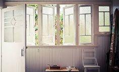 Door. Windows. Panel walls. White.