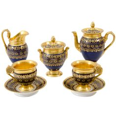 Paris Gilt and Cobalt Decorated Porcelain Tete a Tete Late century Comprising a coffee pot, height 6 inches; and two coffee cups and saucers.