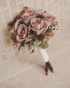 Roses in subtle shades of cream and dusky pink were used to create a 1920s vintage theme for Jo and Michael's wedding at Goldsborough Hall. Flowers by Twisted Willow