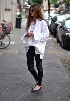 over sized white blouse | black leather pants