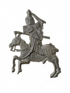 This badge depicts a jousting knight. The knight carries a shield with the cross of St George, who became the patron saint of England during the wars with France in the 1300s. Jousts were good training for combat as well as tests of bravery and skill, and proof of nobility. Several badges depicting knights jousting in tournaments have been found in London. Early-mid 14th century | Museum of London
