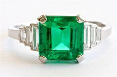 Colombian Emerald Diamond Platinum Ring | From a unique collection of vintage engagement rings at https://www.1stdibs.com/jewelry/rings/engagement-rings/
