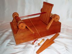 Box Loom  Also known as a tape loom. Based on a 16th century design, this box loom is designed for weaving narrow wares (aka, tapes) on the go! The examples shown below are made of cherry.  Each box loom comes with a heddle (approximately 12 epi), a beater sword, and three bobbins.