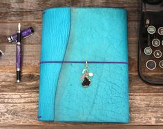 Turquoise Trail Wrap Leather Quill Travelers Notebook from The Leather Quill Shoppe