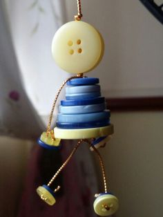 Button craft figurine yellowy one