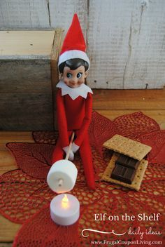 Elf Makes S'mores with a Flameless Candle. Dozens of Easy and Creative The Elf on the Shelf Ideas found on Frugal Coupon Living.