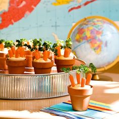 HUMMUS AND BABY Carrot Patches WITH A CURLY PARSLEY SPRIG...IN A SMALL PLASTIC CUP. FOR PRESENTATION PLACE CUPS INSIDE MINI TERRA COTTA POTS