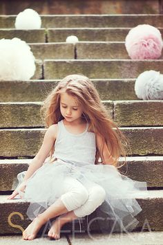 Oooh... tulle on the stairs with pompoms.