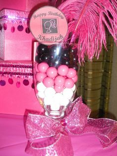 Easy Table Decoration - use plastic glasses from Dollar Tree, fill with pretty candies, and tie with a bow!