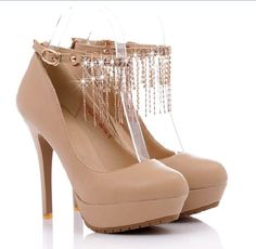 Beige Platform pumps with awesome bling