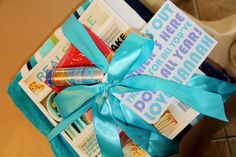 End of the year gift for a teacher: Beach towel, magazine, sunscreen, and treats! Tag reads: School's out, summer's here. Thanks for all you've done all year!